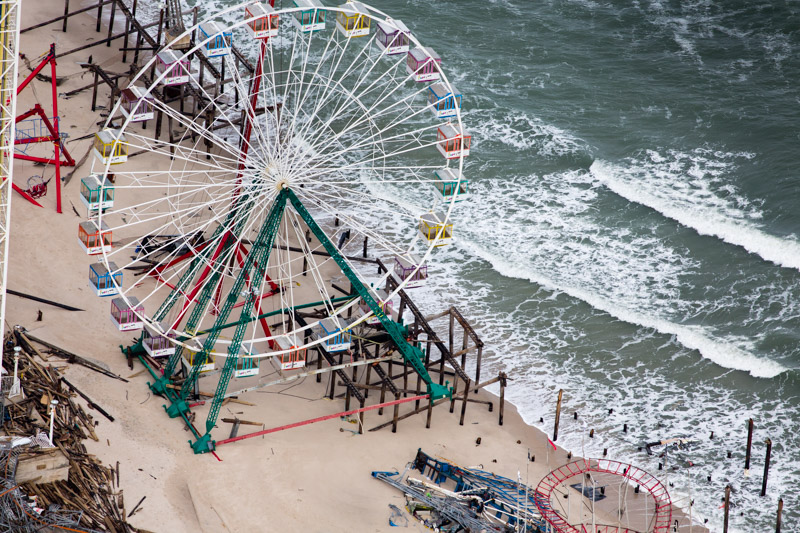 Ferris Wheel Ride Post Hurricane Sandy, Seaside Heights, NJ. November 2012 The joy of the seaside has been seriously disrupted by the devastation of Hurricane Sandy and the disappearance of a beach that was once wide.