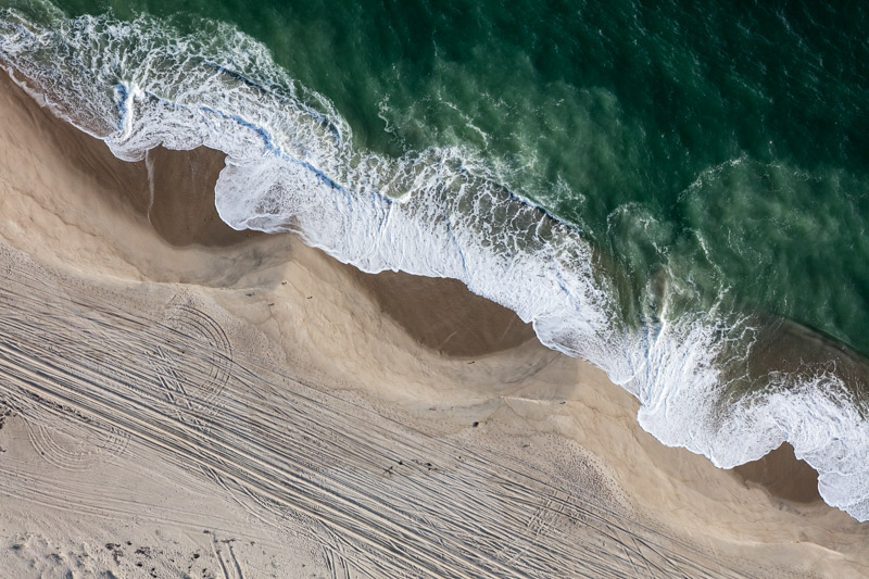 Shoreline Beach Zones at Smith's Point, Nantucket, MA. Sept 2018 The marks on a shoreline are telling. Beaches are constantly shifting, affected by slope, tides, wave action, and winds. Here, there are surf and swash zones, as well as visible signs of human intervention and activity.